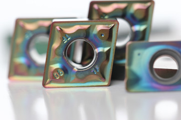 PVD hardcoating on indexible inserts for metal cutting.